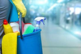 Cleaning products in blue bucket