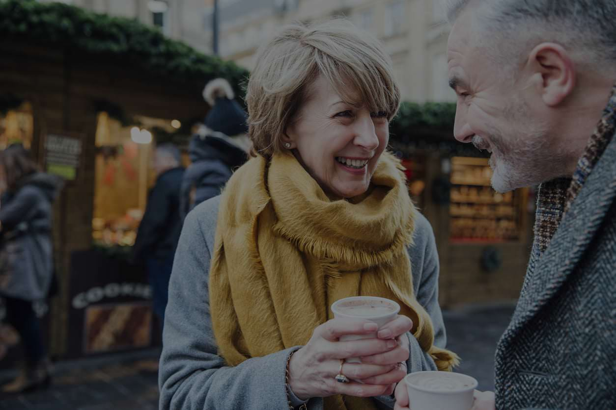 Man and woman holding coffee
