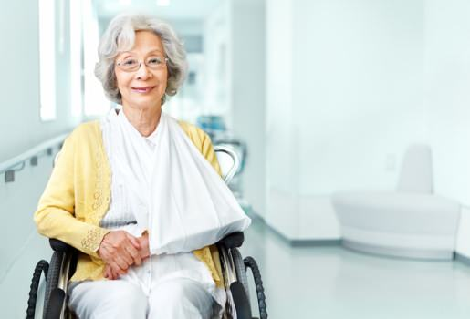 Lady in wheelchair with sling on arm